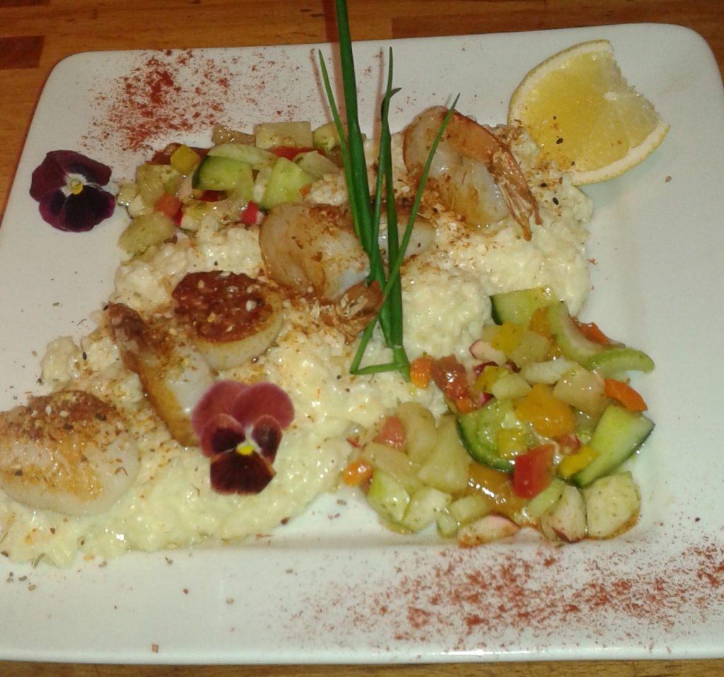 Fruits de mer sur un lit de risotto crémeux